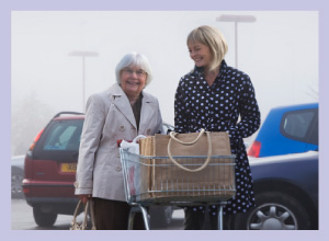 caretaker grocery shopping with woman